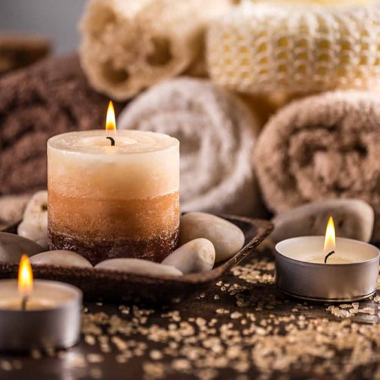 Spa still life with aromatic candles and towels